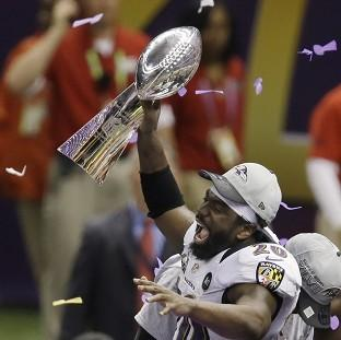 Baltimore Ravens safety Ed Reed holds the Vince Lombardi Trophy (AP)