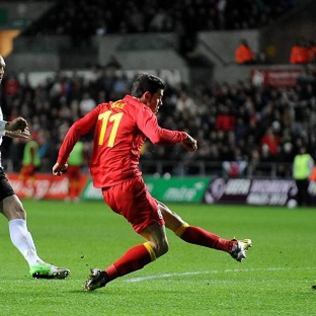 Gareth Bale slots home the opening goal for Wales against Austria