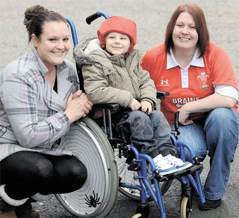 HELPING HAND: Landlady of the Waterloo Inn in Cwmbran, Vicky Augustus, right, with Lukus Morton and his mother Claire Broad. Vicky's pub is holding a pool tournament to raise enough money for a special tricycle for Lukus