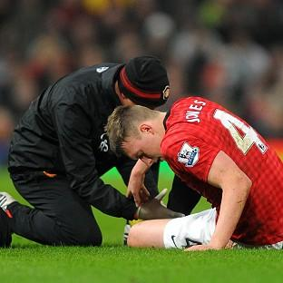 Phil Jones, right, hurt his ankle in the first half after a tackle with Jobi McAnuff