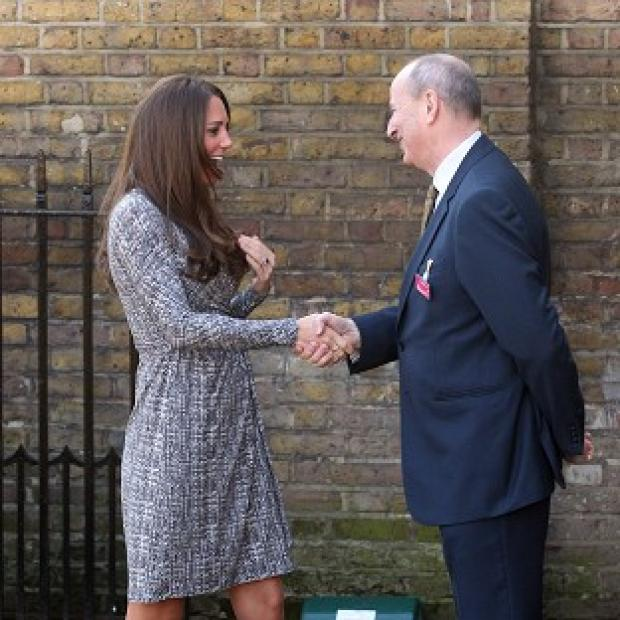 The Duchess of Cambridge is greeted by Nick Barton, chief executive of Action on Addiction as she arrives at Hope House in Clapham