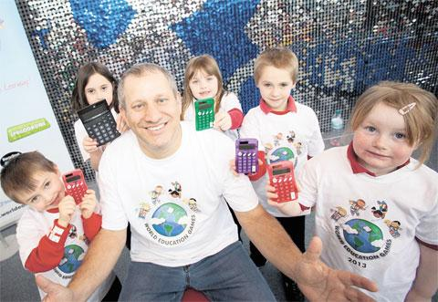 FUN WITH NUMBERS: Human calculator Scott Flansburg is pictured with Kymin Primary School pupils