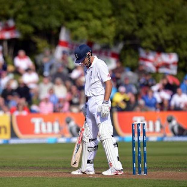 England captain Alastair Cook reacts after being caught by New Zealand's Hamish Rutherford