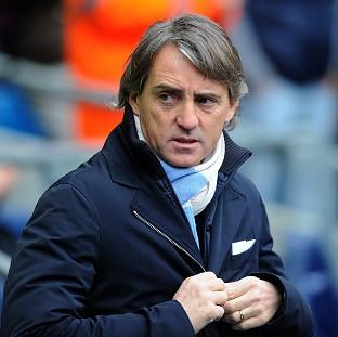 Roberto Mancini, pictured, does not believe Wayne Rooney will leave Manchester United