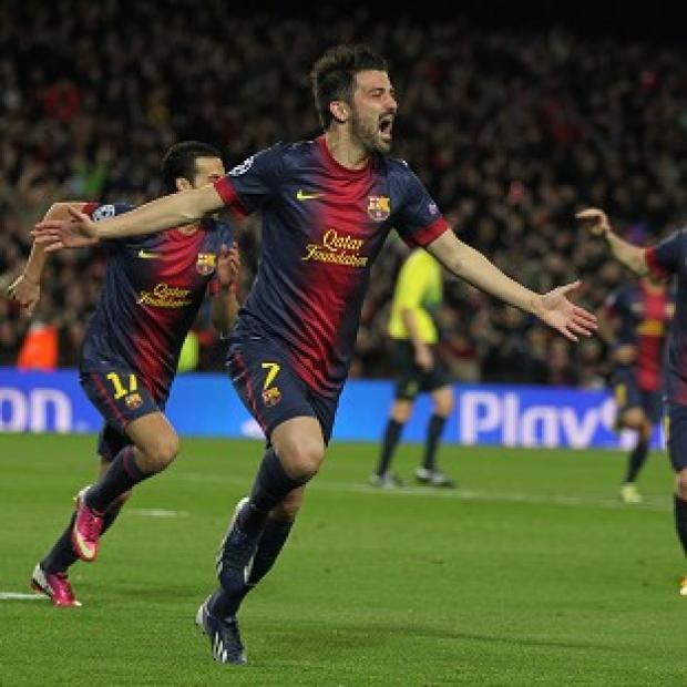 Barcelona beat AC Milan 4-0 to progress into the Champions League last eight