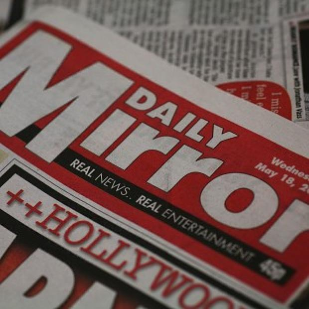 Detectives investigating an alleged phone hacking conspiracy at the Mirror Group have interviewed a 51-year-old man