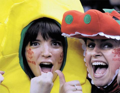 THE FACES OF WALES: Two suitably-dressed fans roar the boys on Gwent erupts on slamtastic day