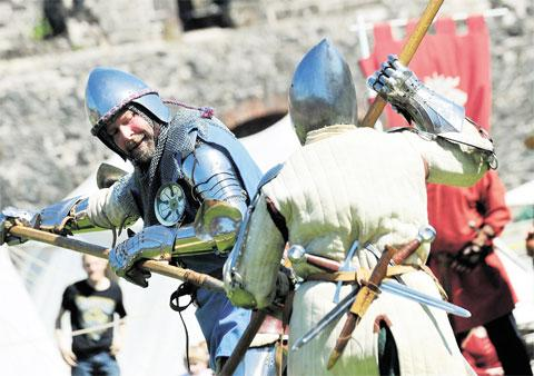 Free Press Series: TAKE THAT! The Freemen of Gwent stage a battle inside Chepstow Castle at the medieval re-enactment event