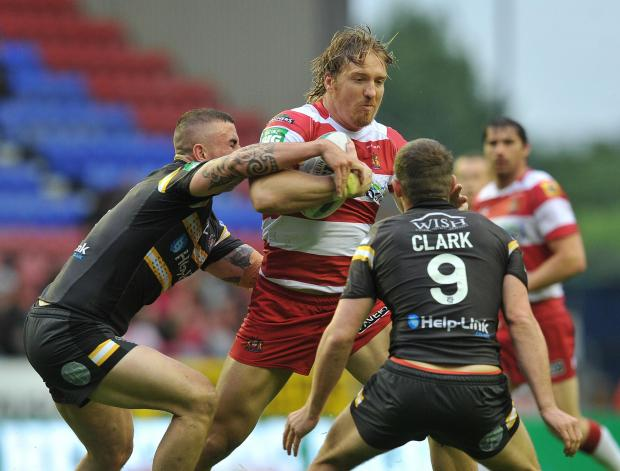 POWER RUNNER: New Dragons flanker Andy Powell in action for Wigan Warriors