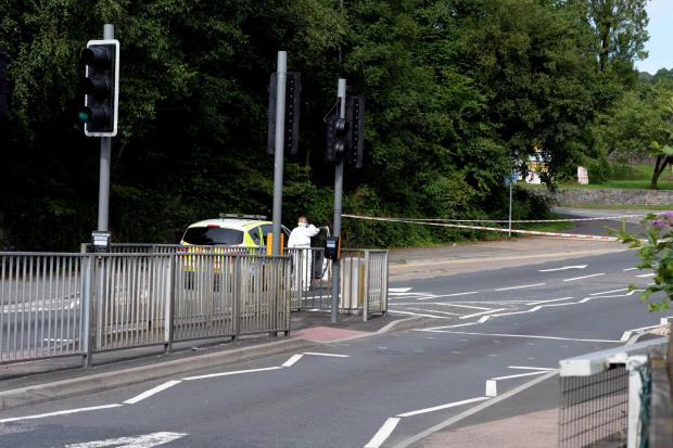 INVESTIGATION: Police cordon off the road where John Reeder, inset, was found