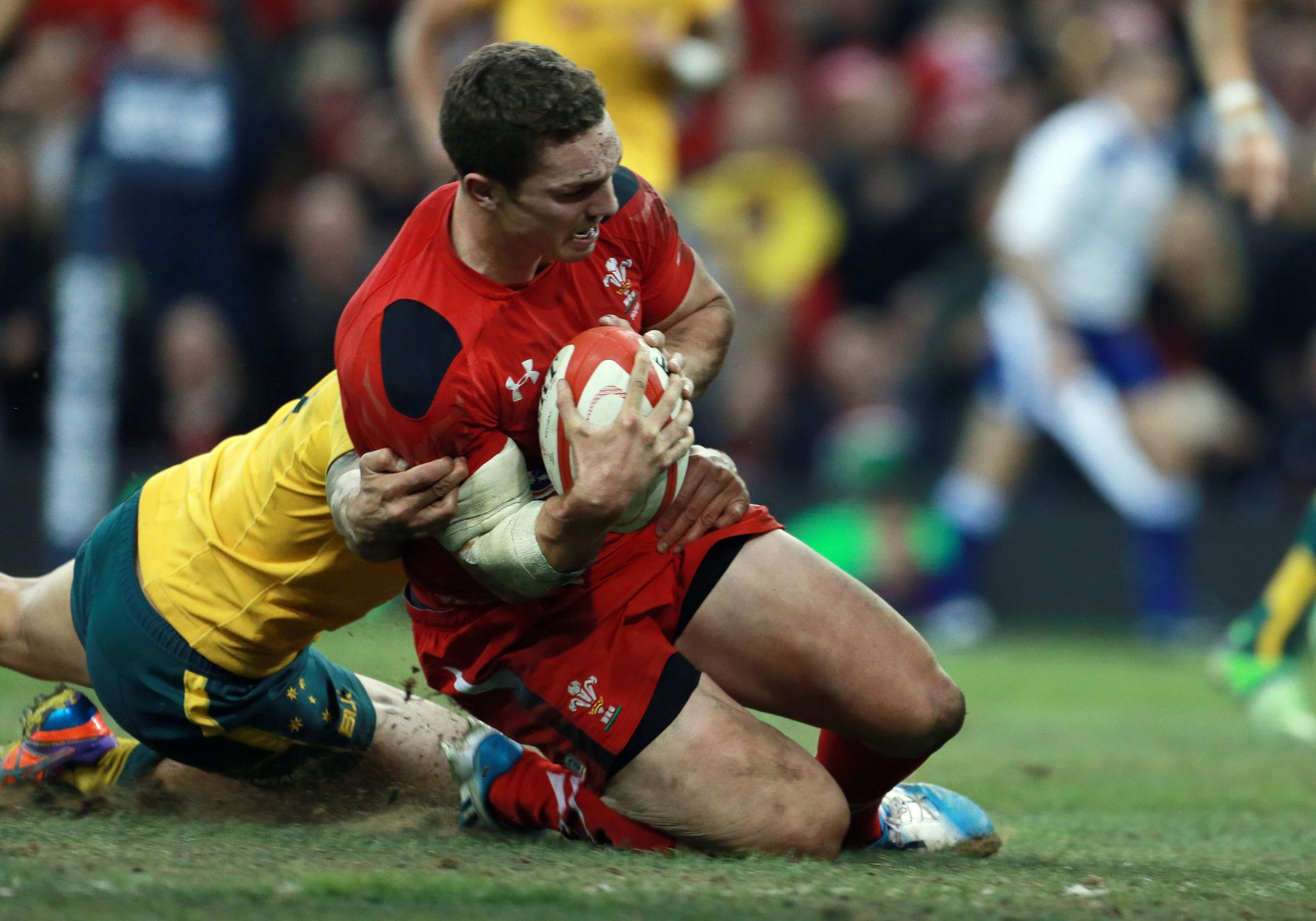 DOUBLE TROUBLE: Wales' George North scores his and his country's second try against Australia