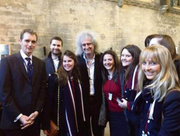 CHANCE MEETING: Year 13 students with Monmouth MP David Davies and Queen guitarist Dr Brian May CBE
