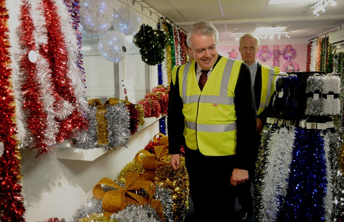 FESTIVE VISIT: First minister Carwyn Jones looks at the tinsel with company owner Anders Hedlund