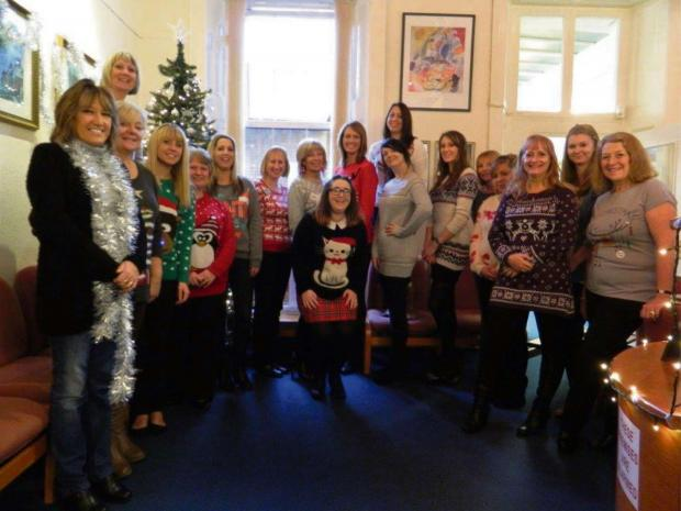 Free Press Series: ITS CHRISTMAS! Watkins & Gunn staff in the festive jumpers