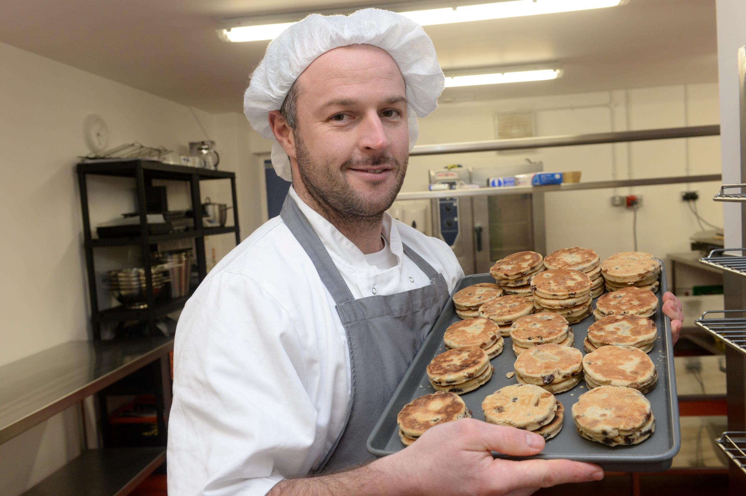 Rhys Thomas, former teacher turned baker and produces gluten and lactose free products. Pictured is Rhys at work in Pontypool making Welsh Cakes (3411091)