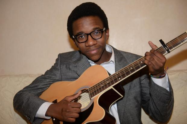 Free Press Series: Sizwe Chitiyo got a guitar in April and self taught himself, and now writes his own material. He is hoping to apply for Britains Got Talent. Pictured is Sizwe at home in Cwmbran. (3358224)