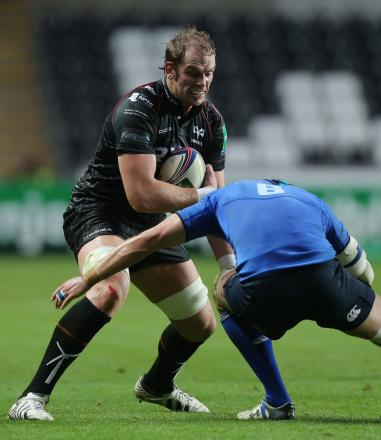 Ospreys captain Alun Wyn Jones trys to break past the the tackle of Leinster's Kevin McLaughlin during the Heineken Cup match at the Liberty Stadium, Swansea. PRESS ASSOCIATION Photo. Picture date: Saturday October 12, 2013. See PA story R