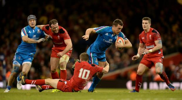 Italy's Alberto Sgarbi is tackled by Wales' Rhys Priestland (number 10) during the RBS 6 Nations match at the Millennium Stadium, Cardiff. PRESS ASSOCIATION Photo. Picture date: Saturday February 1, 2014. See PA story RUGBYU Wales. Photo credit sh