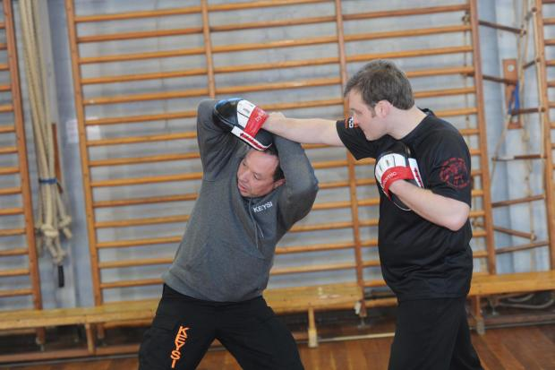 Justo Dieguez founder of fighting band KFM (l) gives a demonstration at Llantarnam (3761770)