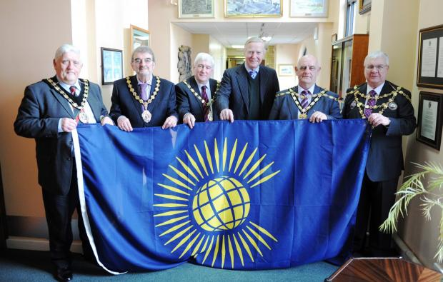 At the Civic Centre Pontypool, the Lord Lieutenant of Gwent, Mr Simon Boyle gave to Mayors of the borough and council leaders, the Commonwealth flag to be flown during the 2014 games.  Pictured centre is Lord Lieutenant of Gwent with Mayors and Council Le