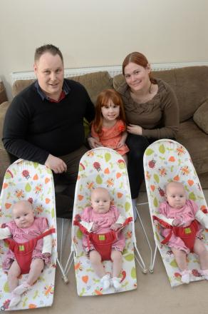 Karen and Ian Gilbert with their identical triplets who are now 6 months old. Pictured are (left to right) Ffion, Maddison and Paige, with Dad Ian, Mum Karen and Faye, 4. (4086705)
