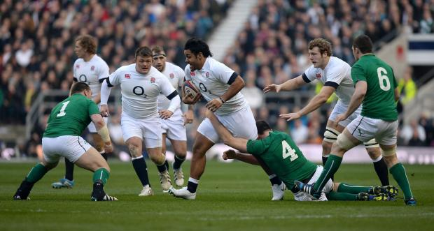 England's Billy Vunipola (centre) breaks away from a tackle by Ireland's Devin Toner during the RBS 6 Nations match at Twickenham Stadium, London. PRESS ASSOCIATION Photo. Picture date: Saturday February 22, 2014. See PA story RUGBYU England. Phot