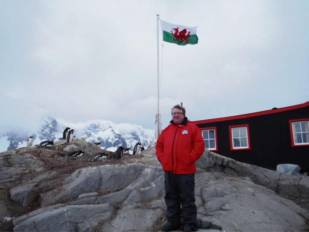 Abergavenny man Christian Brown flies the Welsh flag in Antartica to mark St David's Day