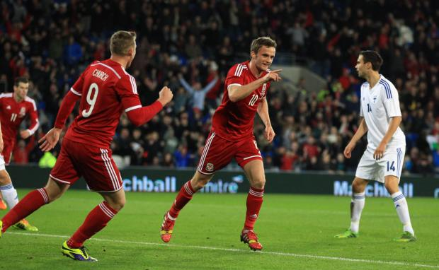 EURO AIM: Wales midfielder Andy King celebrates his goal against Finland last time out