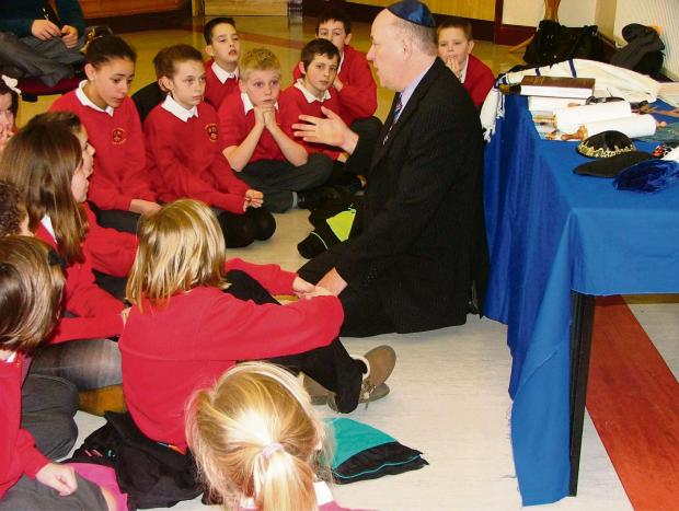 LEARNING: Attentive pupils from Rogiet Primary School listen to the Jewish faith representative.