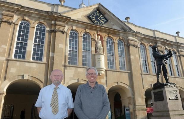 Free Press Series: Monmouth has just been named in the top four towns to live in the UK. Pictured are Monmouth residents Duncan Wills and Phil Mundy outside Monmouth Shire Hall. (4606908)