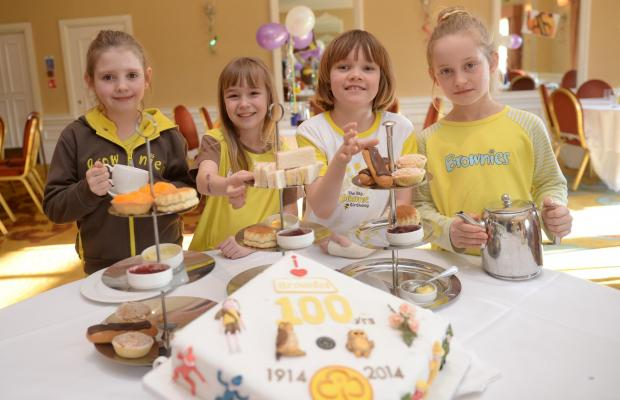 Caldicot and Portskewett branches celebrate 100 years of the Brownies. (left to right) Erin Beasley, Rose Williams, Megan Bayton, and Jessica Reed enjoying their tea and cake. (4471065)