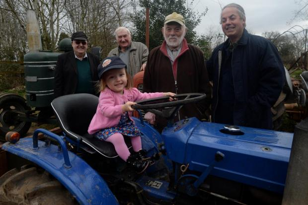 The Chepstow and District Vintage Club are holding a tractor road run and will donate the funds to 'Help Imogen Walk Appeal' IN THE DRIVING SEAT  Imogen trys her hand at the wheel of a vintage tractor. Pictured behind, from left are, David Powell,