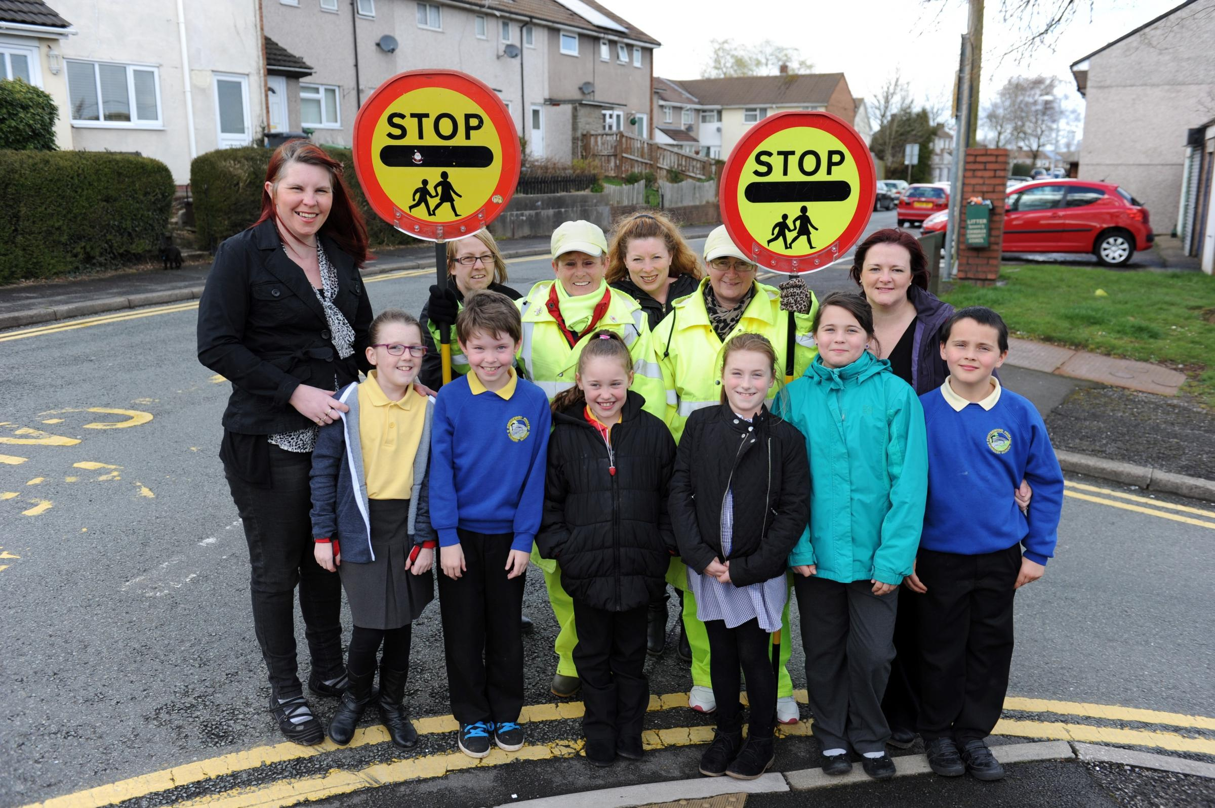 A group of parents, led by Kathy Fields and Nicky Harris have started a petition to save school crossing patrols at Pontnewydd Primary School.  Pictured are parents with children at the Bryn Celyn crossing point. (4788059)