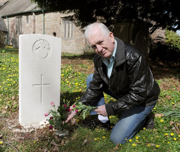 Free Press Series: Shaun McGuire at the grave of his Great Uncle Penry Morgan at the Church of St Michael and All Angels in Llantarnam