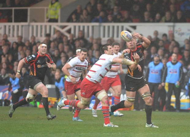 Newport Gwent Dragons v Edinburgh - Rodney Parade. Lewis Evans is tackled. (5106611)