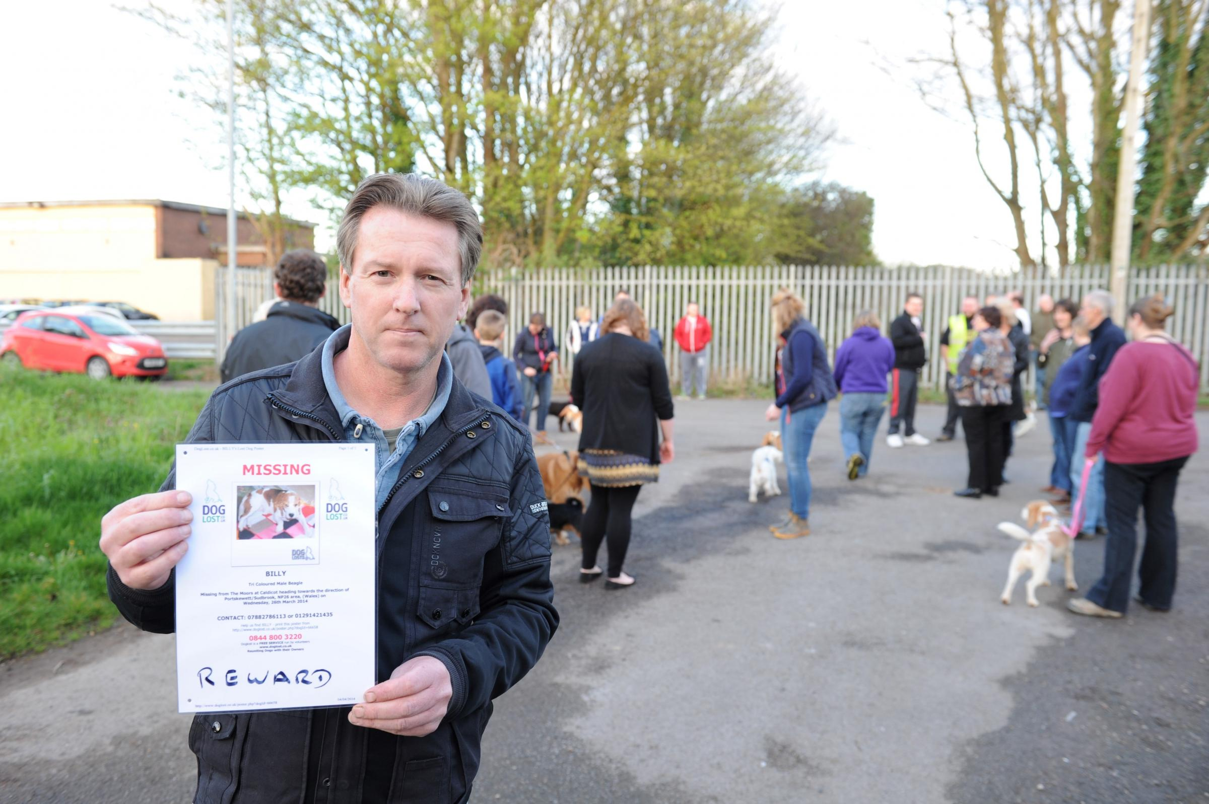 Twenty plus people have rallied together in the community over the last week to help Chris Carter search for his missing beagle Billy.  Pictured is Chris with a poster of his missing dog Billy. (5165080)