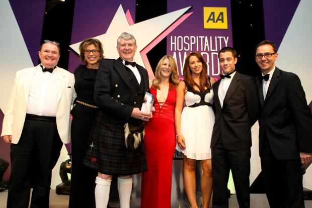 Free Press Series: AWARD: The Inn was named AA Pub of the Year for Wales in 2013, owners Andrew and Jackie Murphy (centre) with staff members and Kate Silverton of the BBC at the awards ceremony
