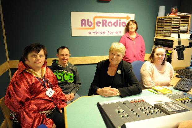 Wales Office Minister Baroness Randerson made a special visit to Able Radio which is social enterprise for people with disabilities based in Ty Nant Ddu.  Pictured is the Baroness with the Buzz Group in Studio 1. (5762654)