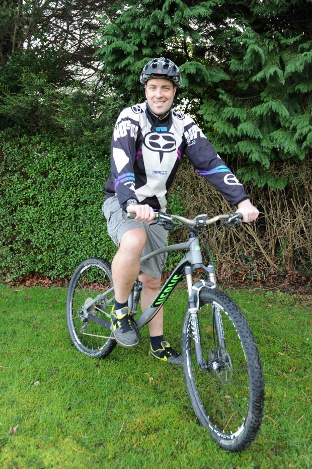 Free Press Series: Pictured on his X Country Mountain Bike is Gareth Bailey.  Gareth is fundraising for the Welsh Air Ambulance who rescued him following a mountain bike accident last year. (3806539)