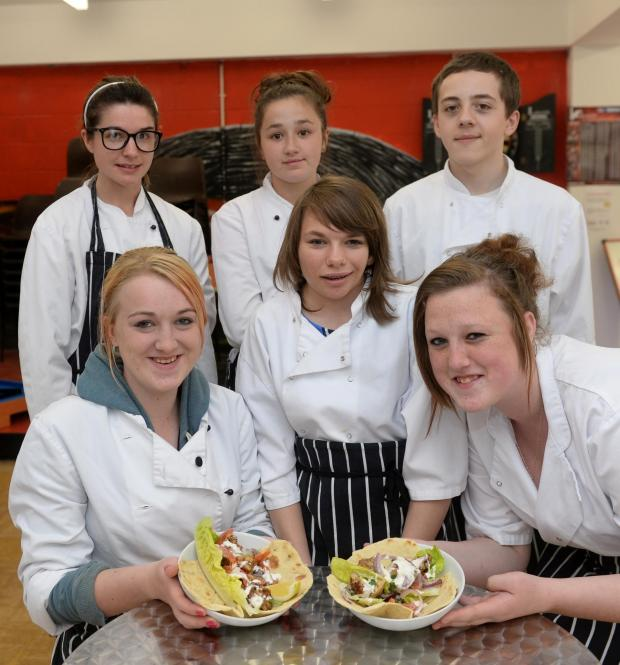 Free Press Series: Young people from Cwmbran invent their own dish to present and sell at the Abergavenny Food Festival. Pictured are Claire Greaves, Katie Nash, Rachel Watkins, Demi Churchill, Dominic Tainton, and Elizabeth Ferguson at Cwmbran Centre for Young people. (669