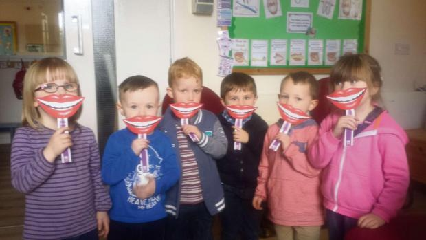 Free Press Series: Children with their smiley mascot: Millie, McCauley, Jack, Darcy, Cole and Lily