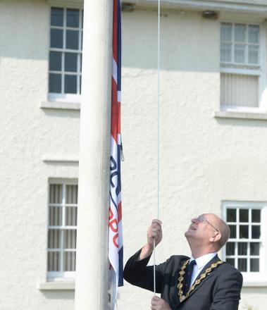 ARMED FORCES DAY: Council Chairman John Prosser raises the flag