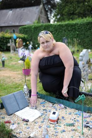 PROTEST: Catherine Board handed a petition in to Torfaen council against new grave decoration policies. Her baby son Brandon is buried at Cwmbran Cemetery.