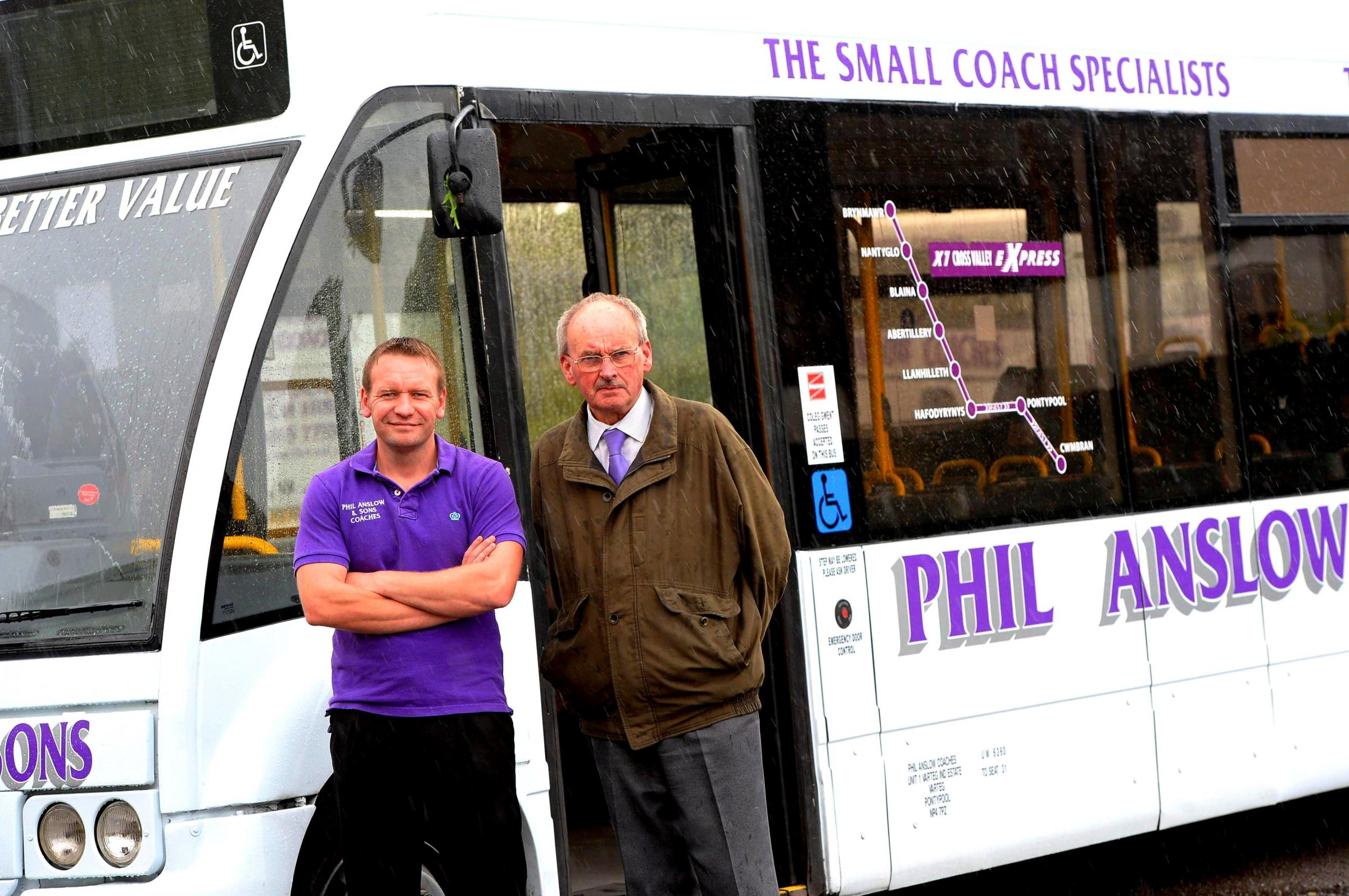 SMART SERVICE: Kevin Anslow, left, and operations manager Terry Wyburn at the bus depot in the Varteg. The Anslow bus service has taken over a route from Stagecoach, much to the relief of the residents