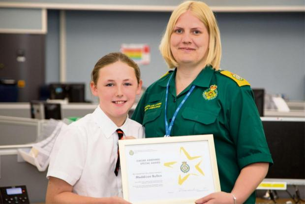 CERTIFICATE:Maddison Bullen received a certificate for her efforts from  Lucy Fisher at  the Welsh Ambulance Service Clinical Control Centre.