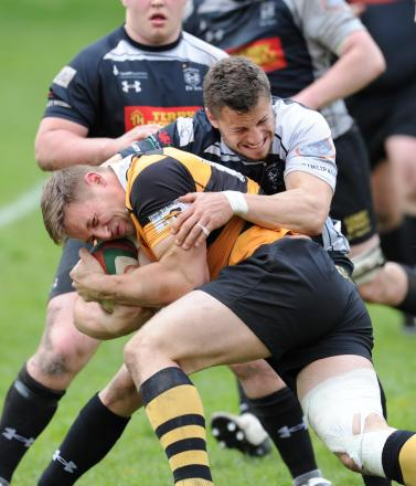 DEFENCE IS KEY: Dorian Jones tackles Dan Robinson while on Cross Keys duty