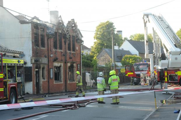 ARSON: Fire crews at the scene of the fire at the Masons Arms in Griffithstown