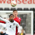 Free Press Series: Nathaniel Chalobah of England holds off Lee Evans of Wales during the 2015 UEFA Under 21 Championship Qualifying, Group One match at the Liberty Stadium, Swansea. PRESS ASSOCIATION Photo. Picture date: Monday May 19, 2014. See PA story SOCCER Wales U21. P