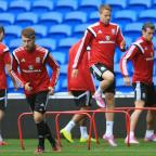 Free Press Series: RULED OUT: Wales will cope without Aaron Ramsey, left, according to Chris Gunter, centre