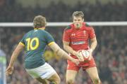 POLISHED PERFORMANCE: Wales fly-half Dan Biggar takes on Pat Lambie